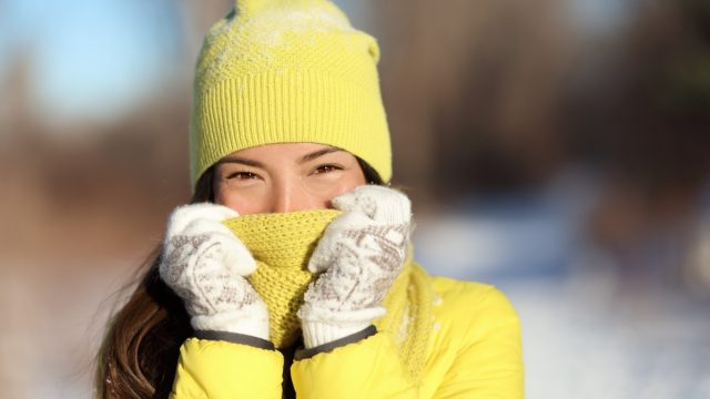 woman covering face from cold