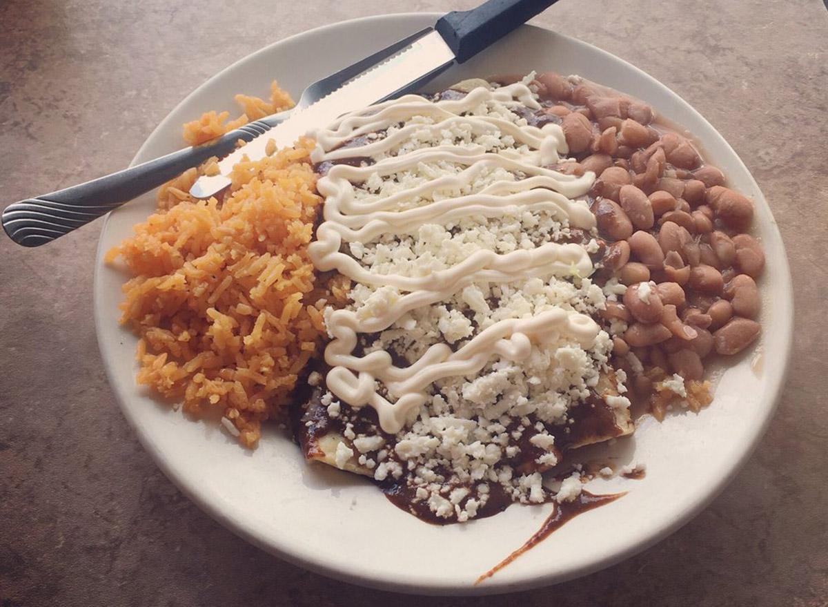 Alambama Antojitos Izcalli enchiladas, beans and rice