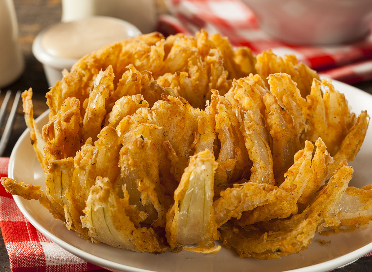 bloomin onion on white plate