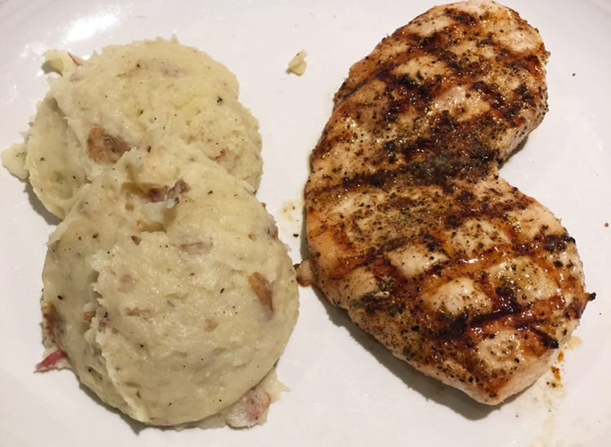 carrabbas tuscan grilled chicken with a side of mashed potatoes