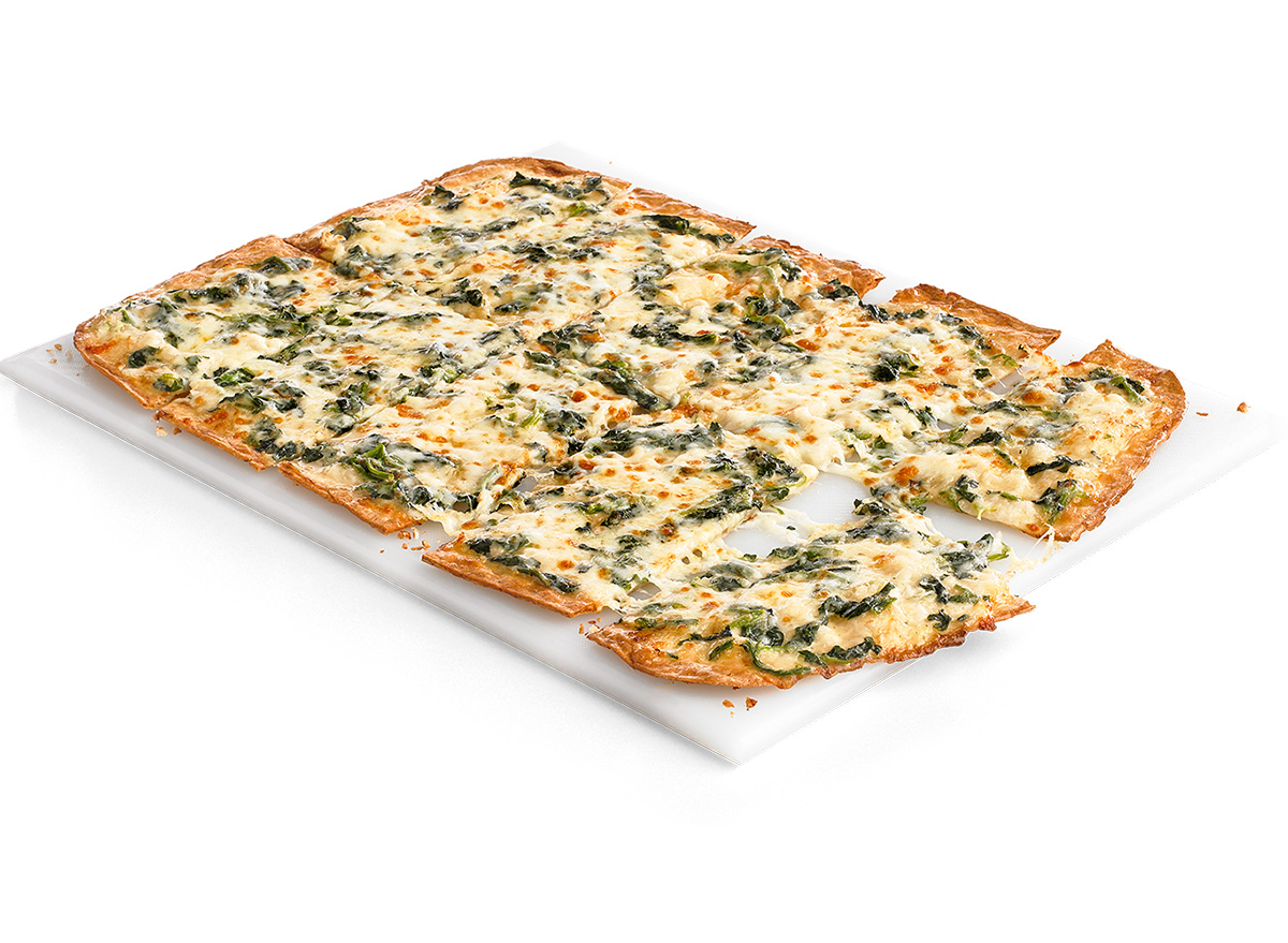 cicis spinach alfredo pizza on white plate