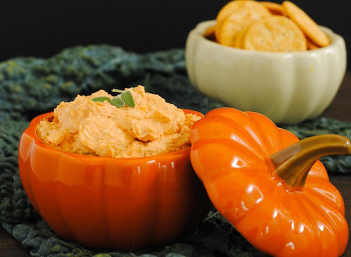 creamy pumpkin parm dip in a ceramic pumpkin