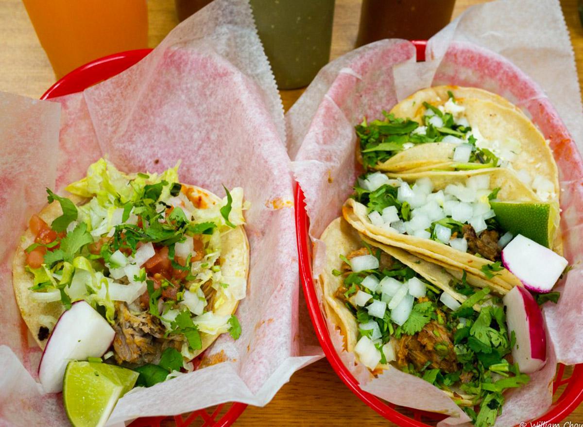 delaware el pique two plastic baskets with tacos inside