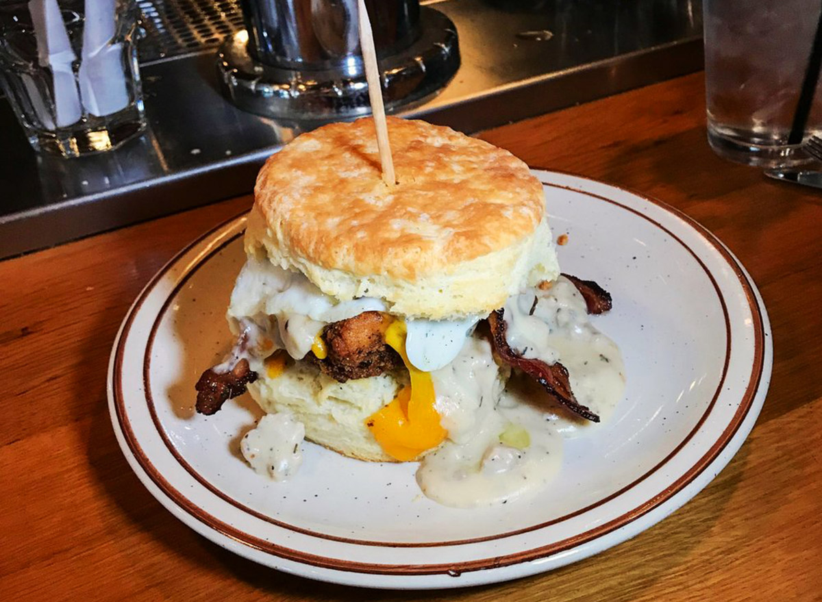 biscuit sandwich with chicken, bacon and cheddar cheese on a plate from denver biscuit company
