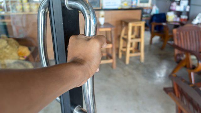 hand opening cafe doors