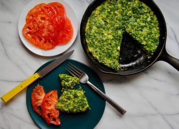 egg and herb frittata in skillet and on plate