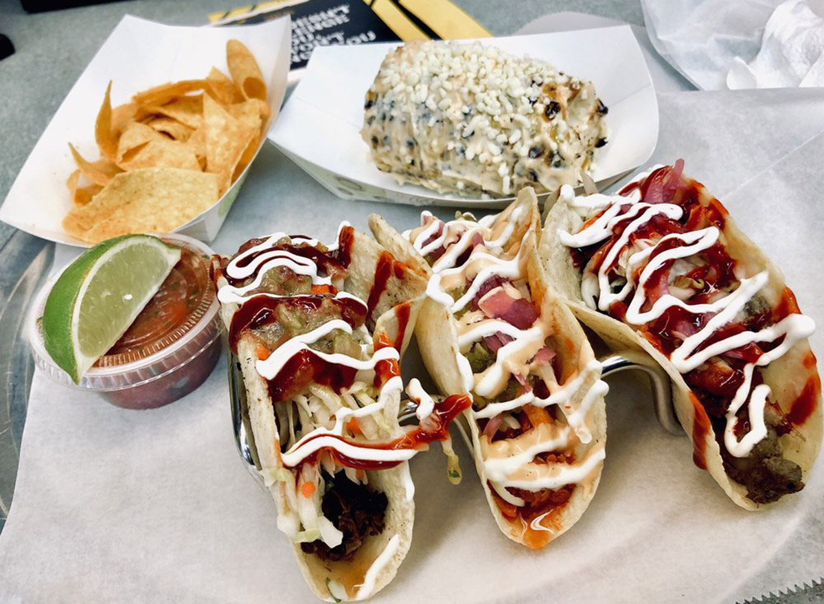 florida los bocados set of three tacos with a lime and salsa