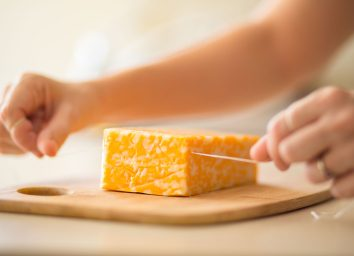 Easily cutting cheese with a piece of floss