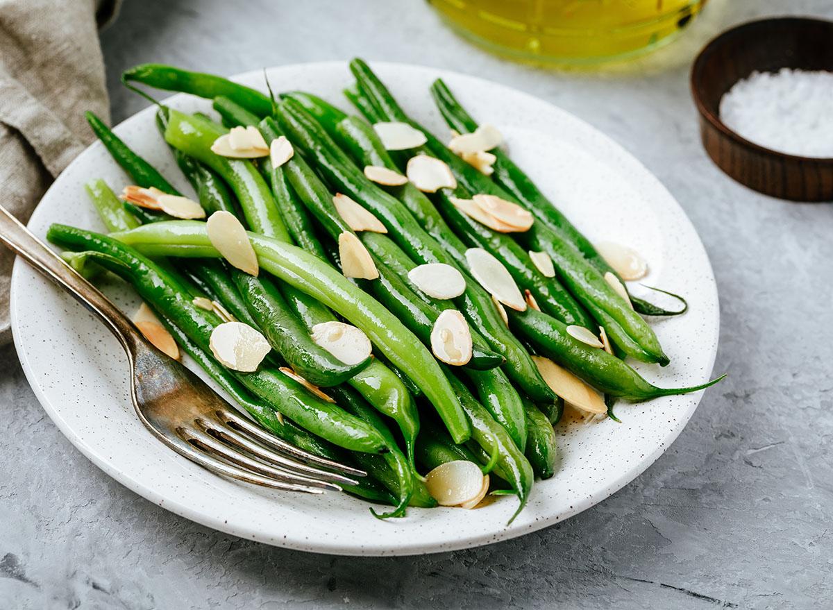 green bean almondine on white plate