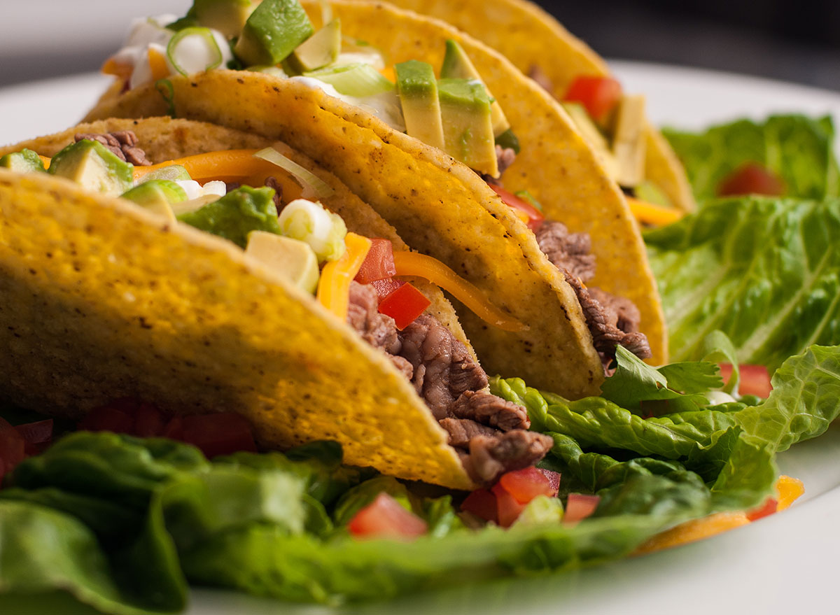 Hard shell tacos wrapped with lettuce