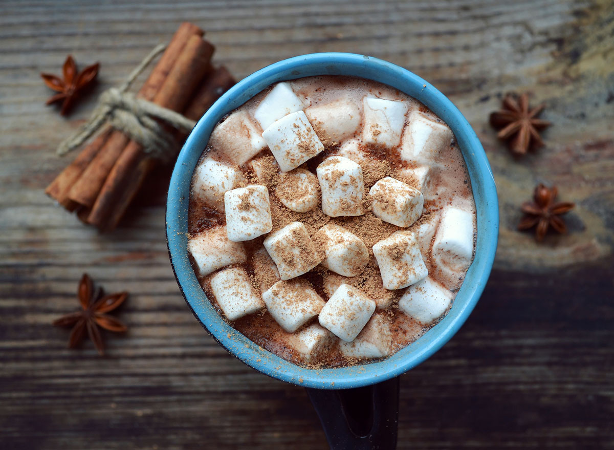 hot chocolate with marshmallows and cinnamon in a blue mug
