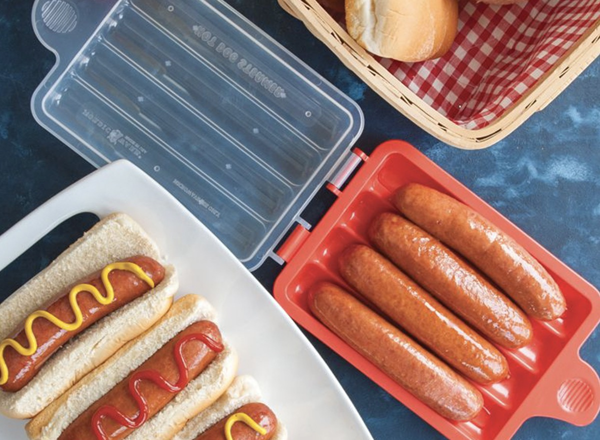 hot dogs in red microwave tray and on white plate