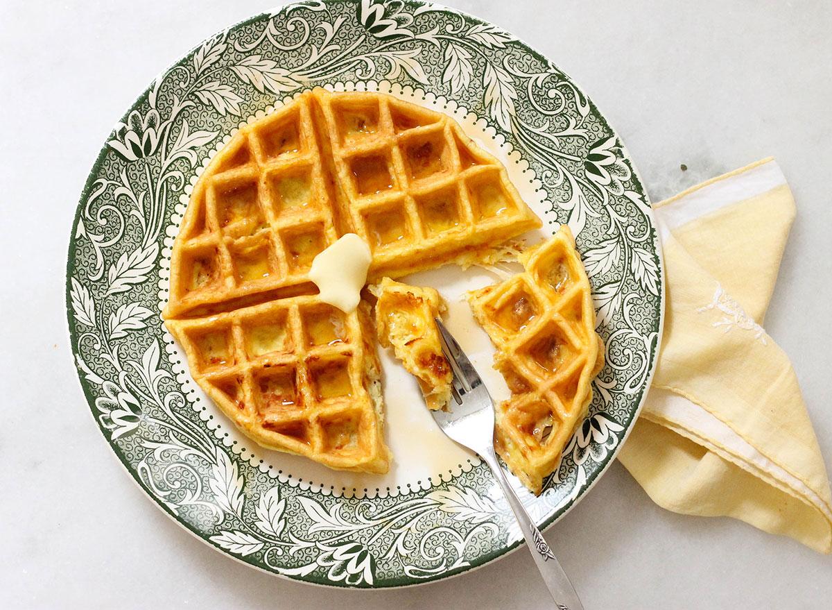 Biting into a keto waffle