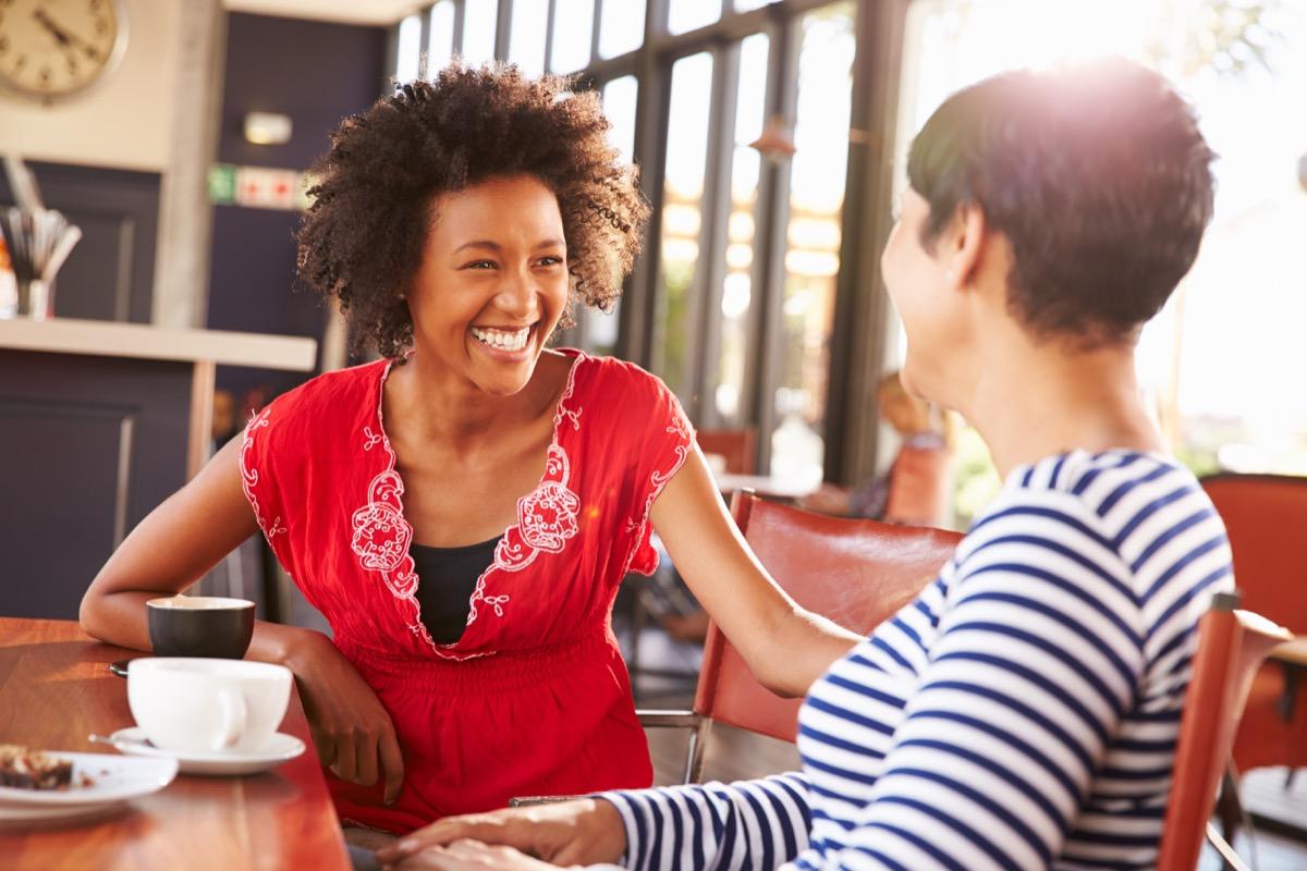 female friends talking at a coffee shop