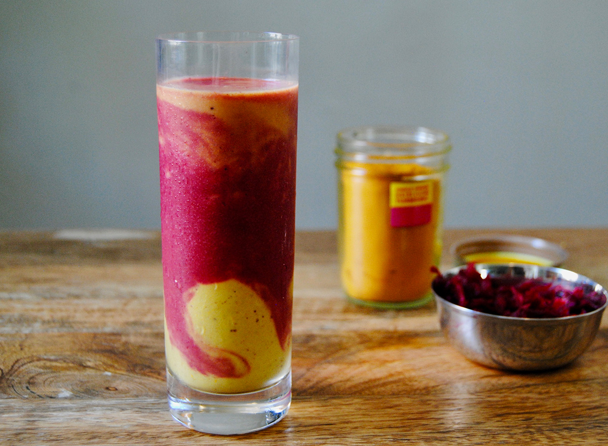 paleo fruit smoothie in glass on wooden surface