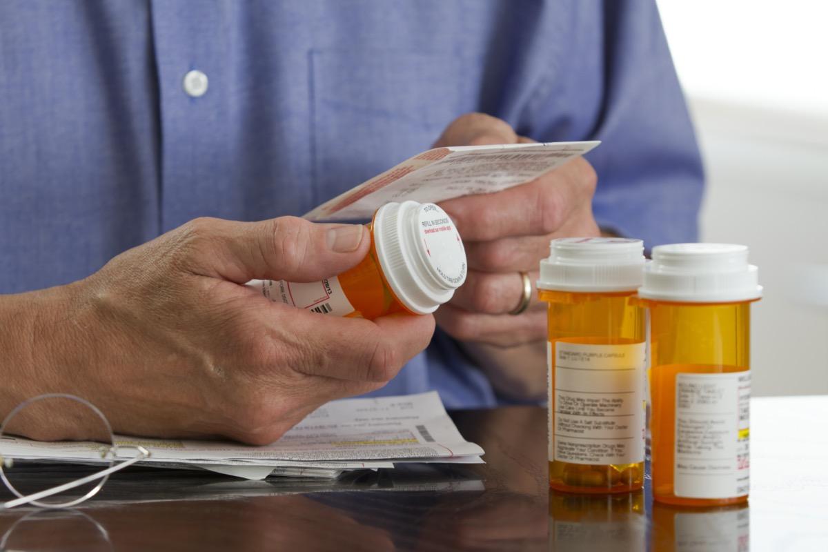 man with prescription medications