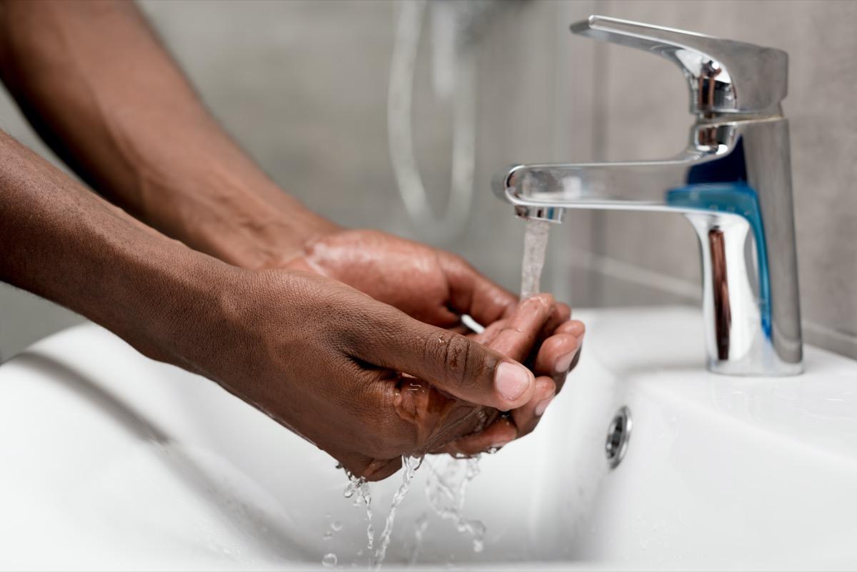 man washing in bathroom