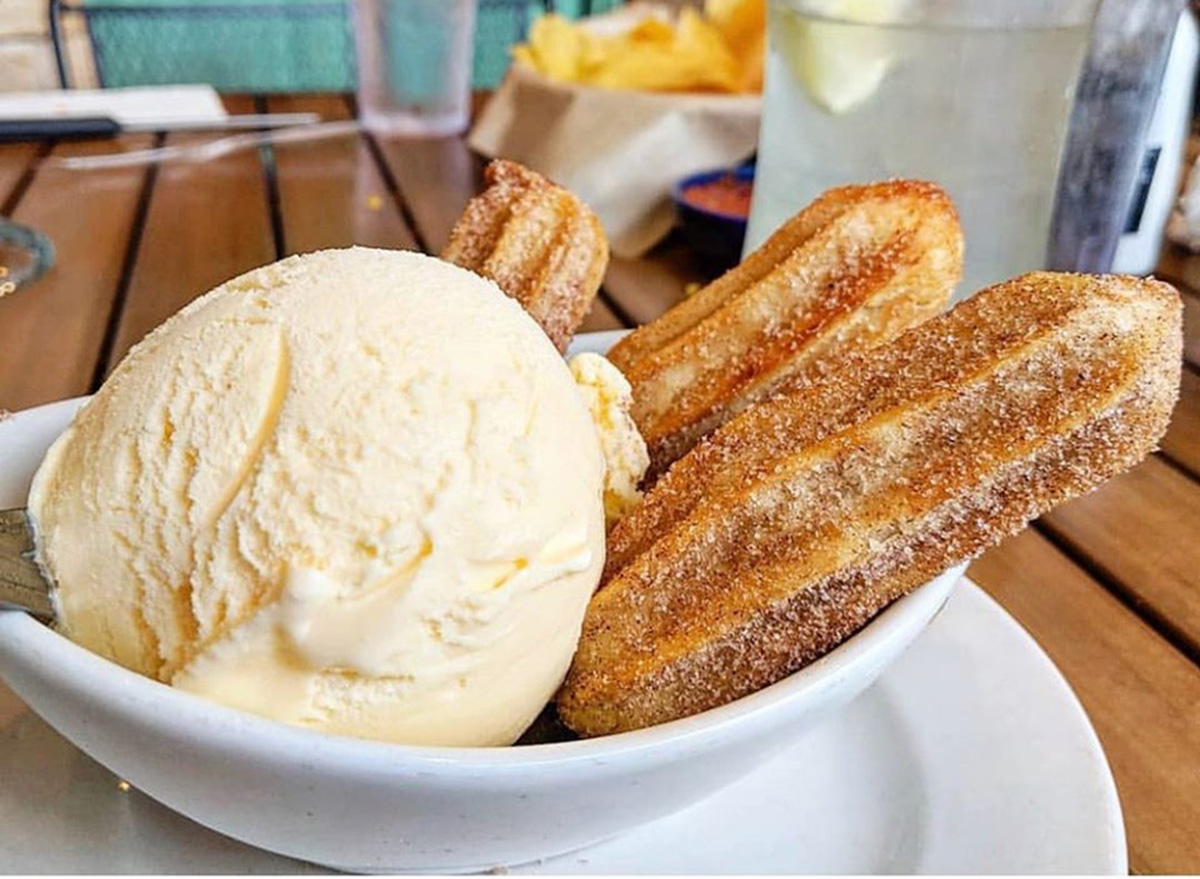 on the border caramel churros with vanilla ice cream scoop