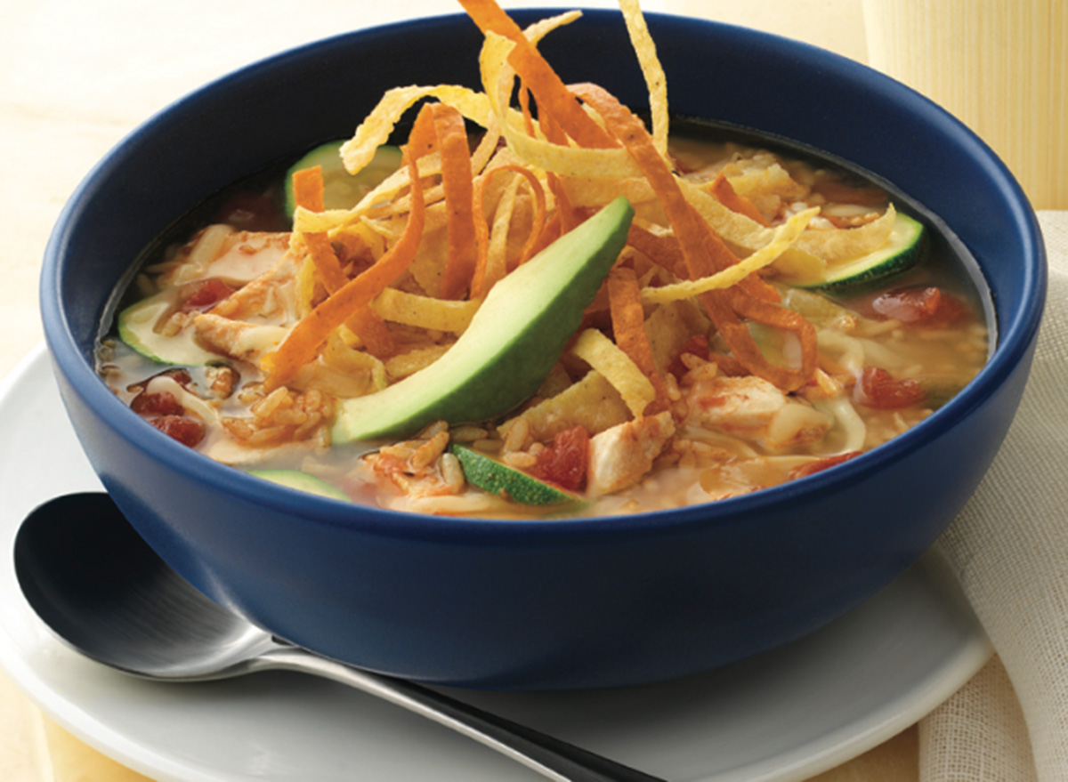 on the border chicken tortilla soup in a bowl and spoon