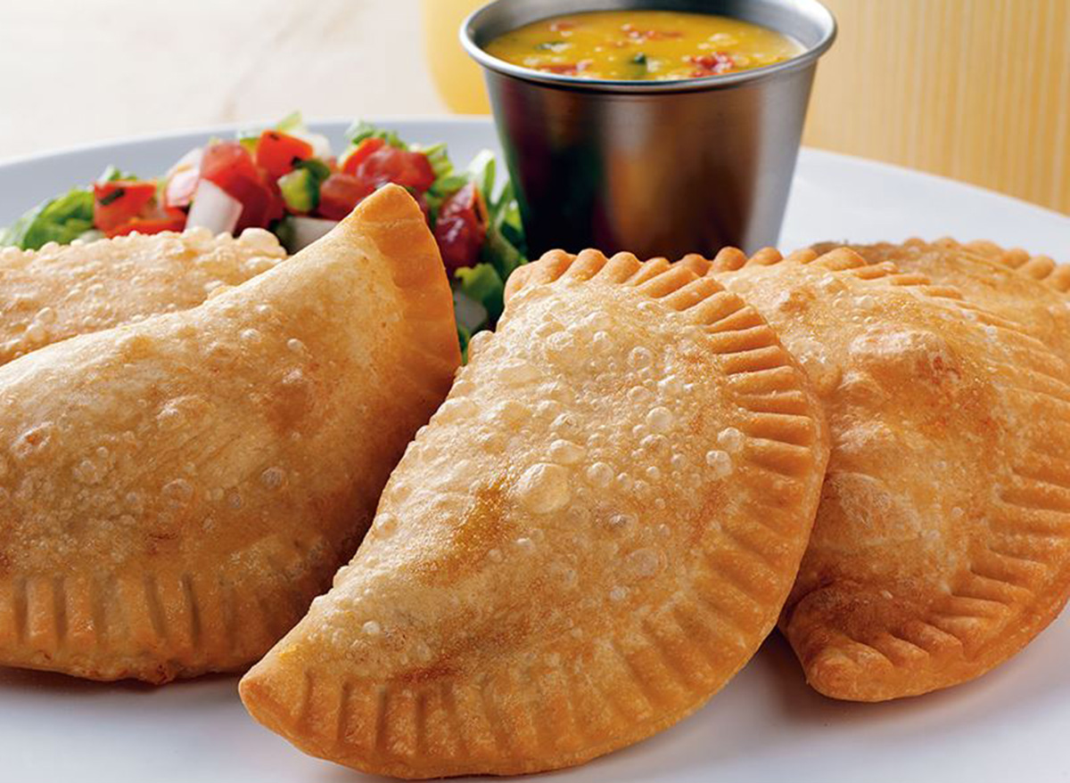 on the border ground beef empanadas with side salad and sauce