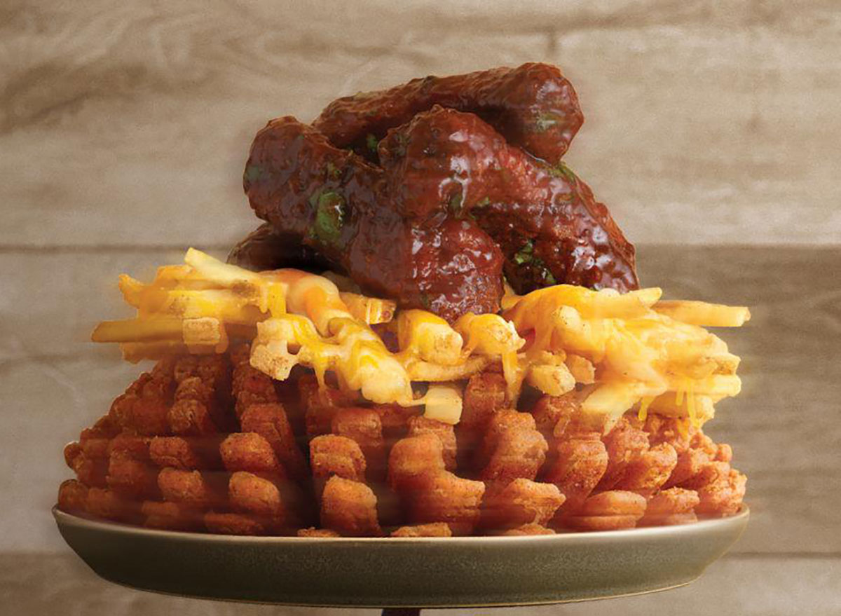 outback steakhouse three point rib bloom with bloomin onion topped wtih cheese fries topped with ribs
