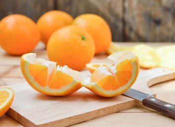 Peeling and unrolling an orange easily on a cutting board.