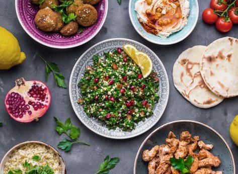 Plant-based diet mediterranean spread tabbouleh salad falafel chicken