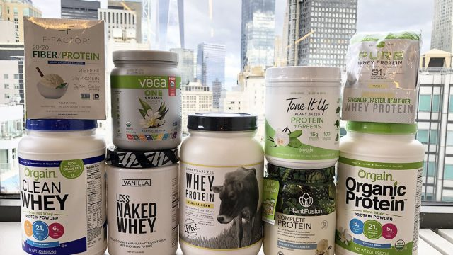 stacked containers of plant based with regular vanilla flavored protein powders
