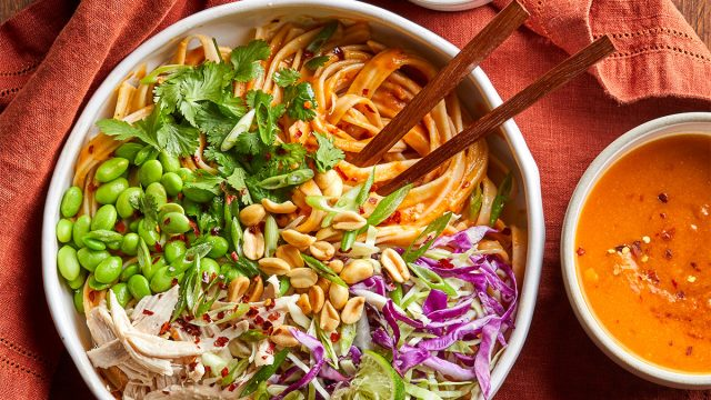 Bowl of pumpkin pad thai with peanuts ready to be eaten