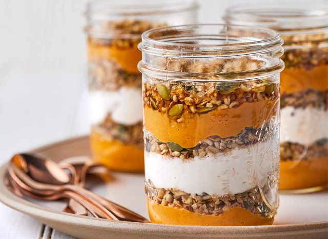 spicy pumpkin parfait in a mason jar with spoons