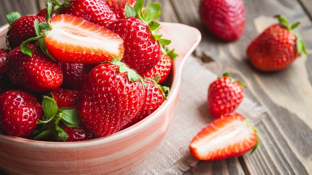 strawberries cut in half in a bowl