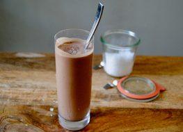 paleo tahini chocolate shake in glass with spoon