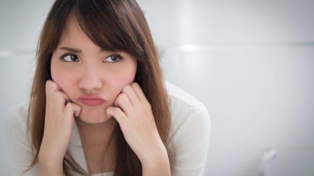 upset woman in toilet by diarrhea, constipation, hemorrhoids, piles