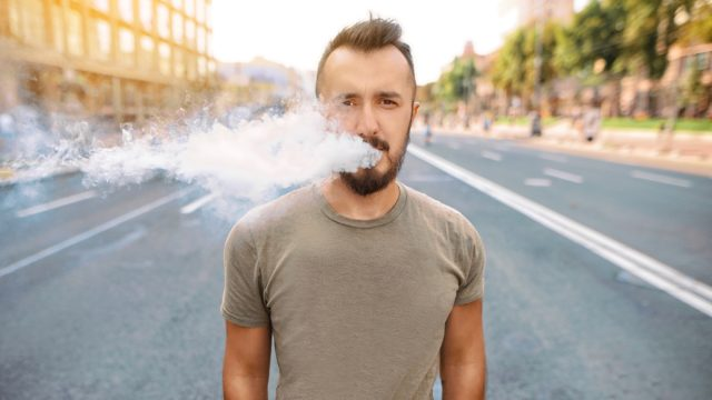 Vaping man smoke