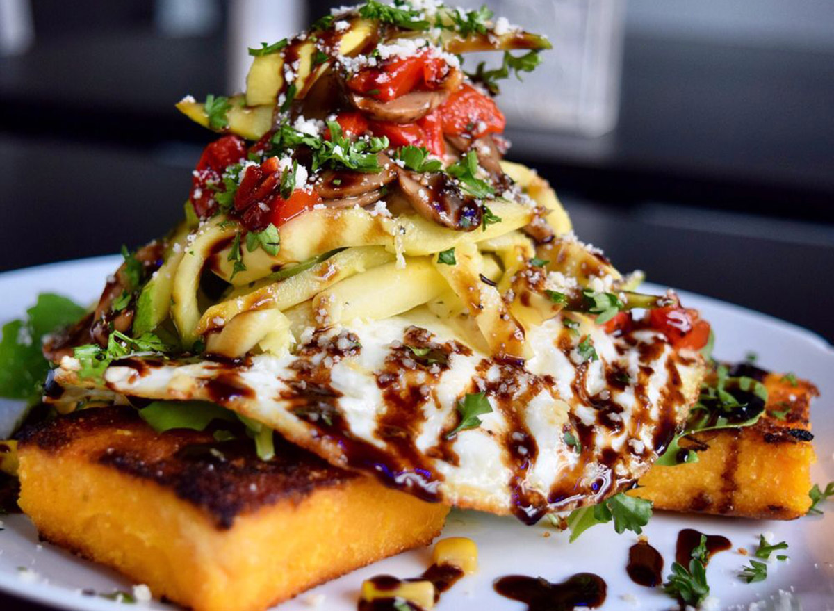 stacked salad with veggies and polenta