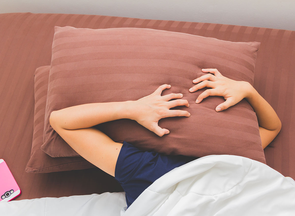 woman cannot sleep with two pillows over face