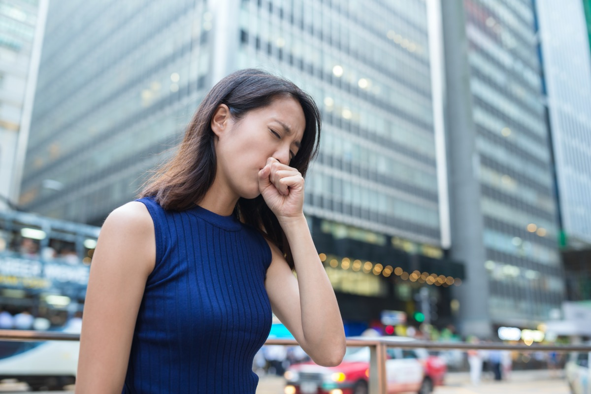 Woman cough at outdoor