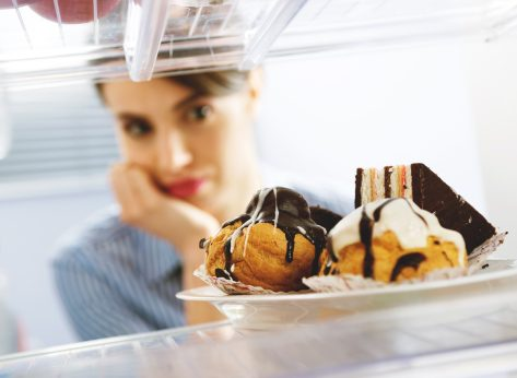 Woman craving junk food while on a diet