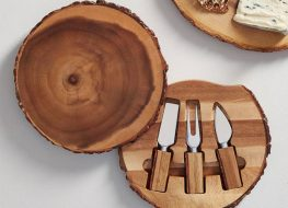 wooden serving plate and cheese serving utensils