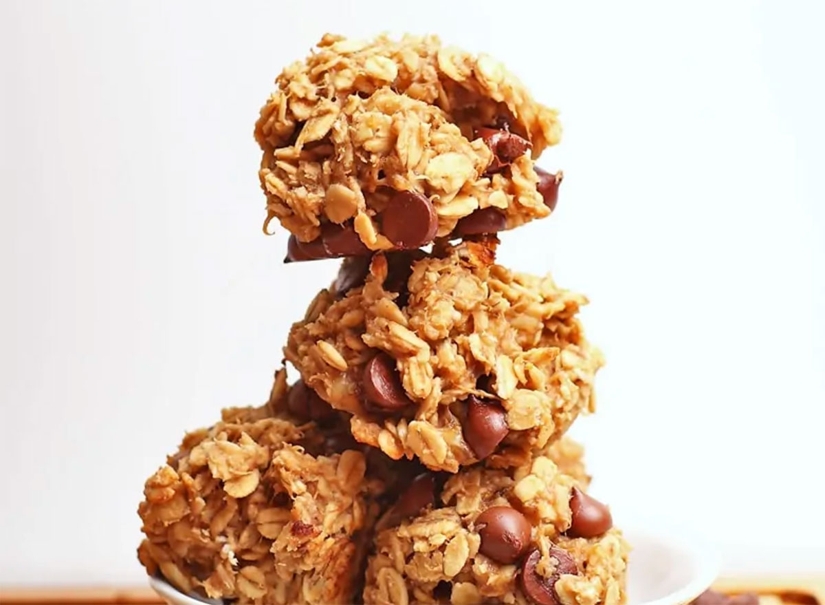Vegan peanut butter chocolate chip cookies piled on top of each other
