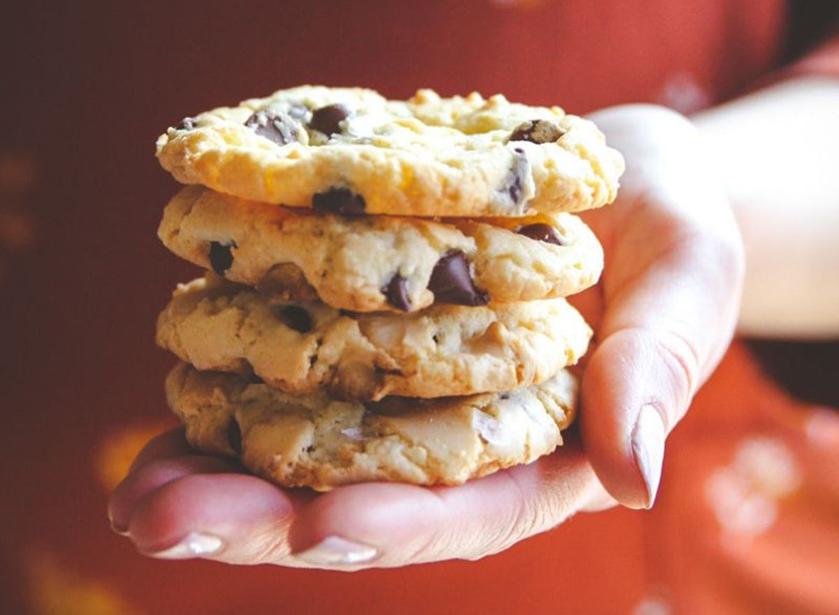 Someone holding a stack of tuxedo chocolate chip cookies