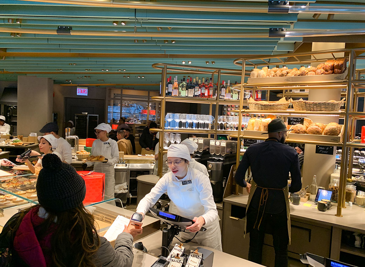 Baker selling food to customer at the Starbucks Reserve Roastery