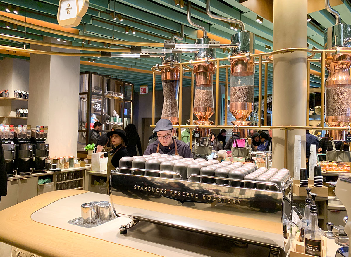 Barista behind the counter at a Starbucks Reserve Roastery