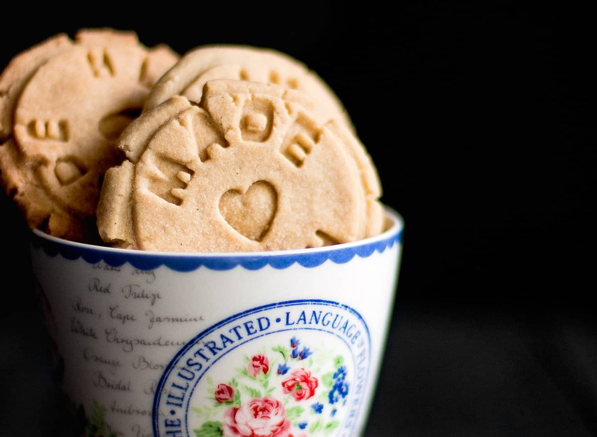 Shortbread cookies in a mug with a dark background