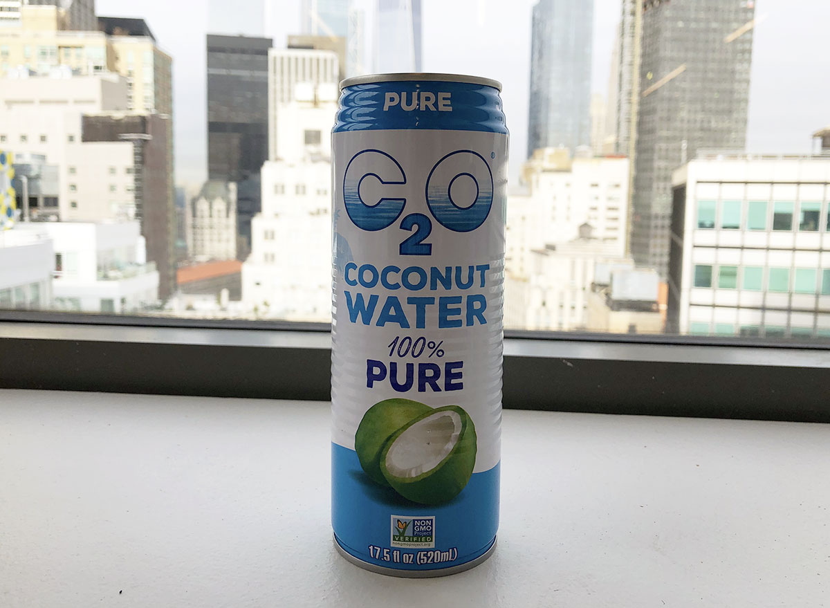 c 2 o 100 percent pure coconut water can by window