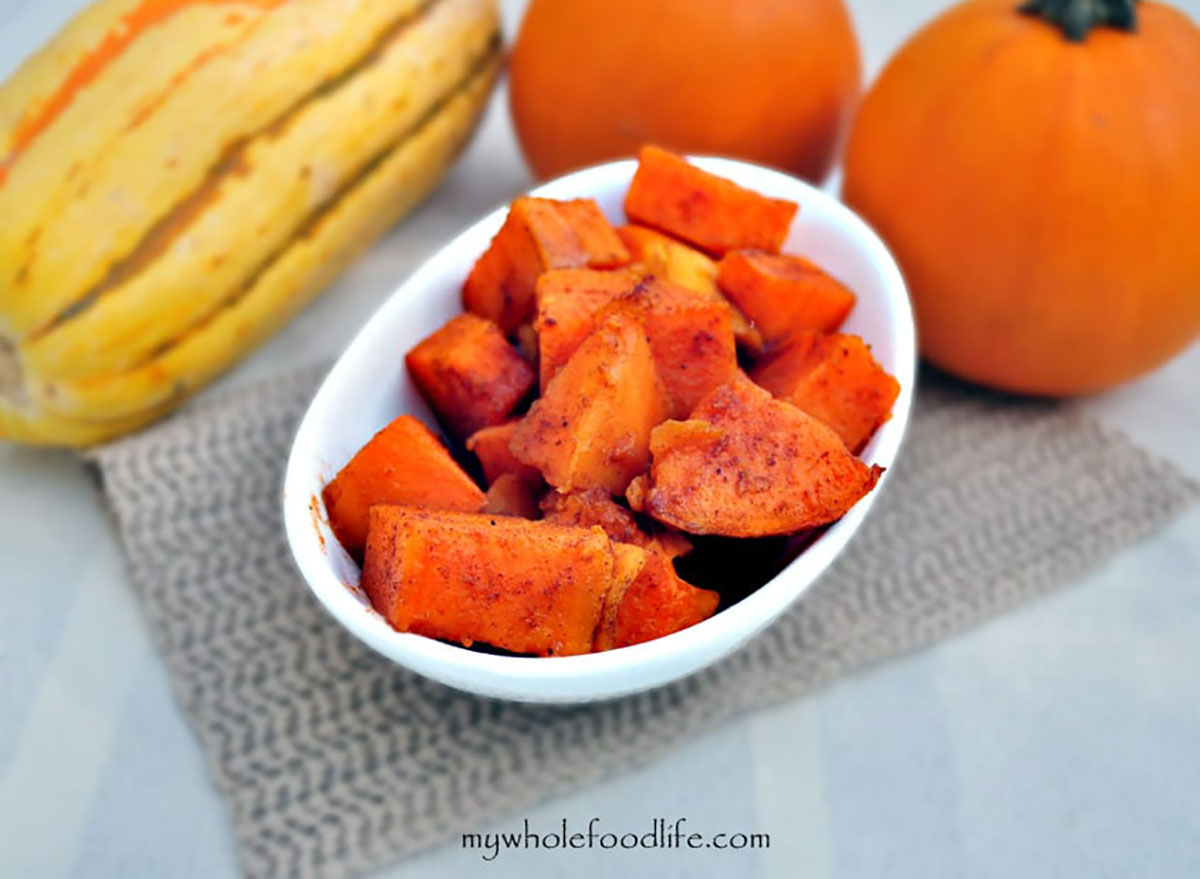 cubed candied yams in white serving bowl