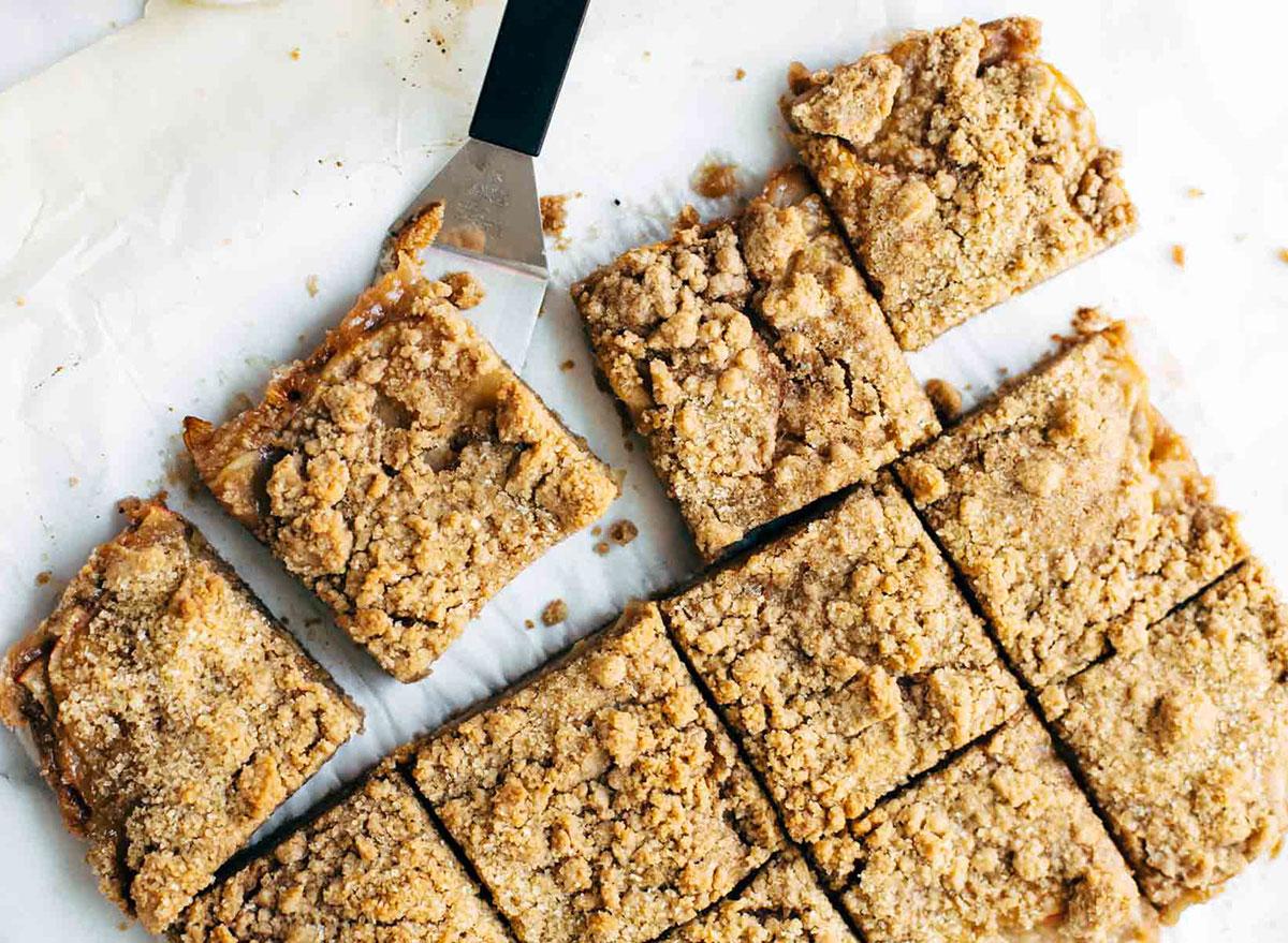caramel apple crisp bar squares on baking sheet