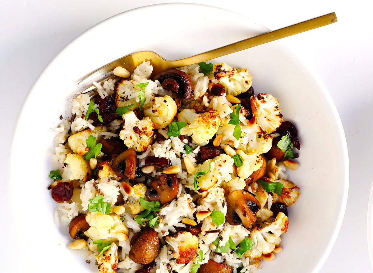 roasted cauliflower with mushrooms and wild rice stuffing