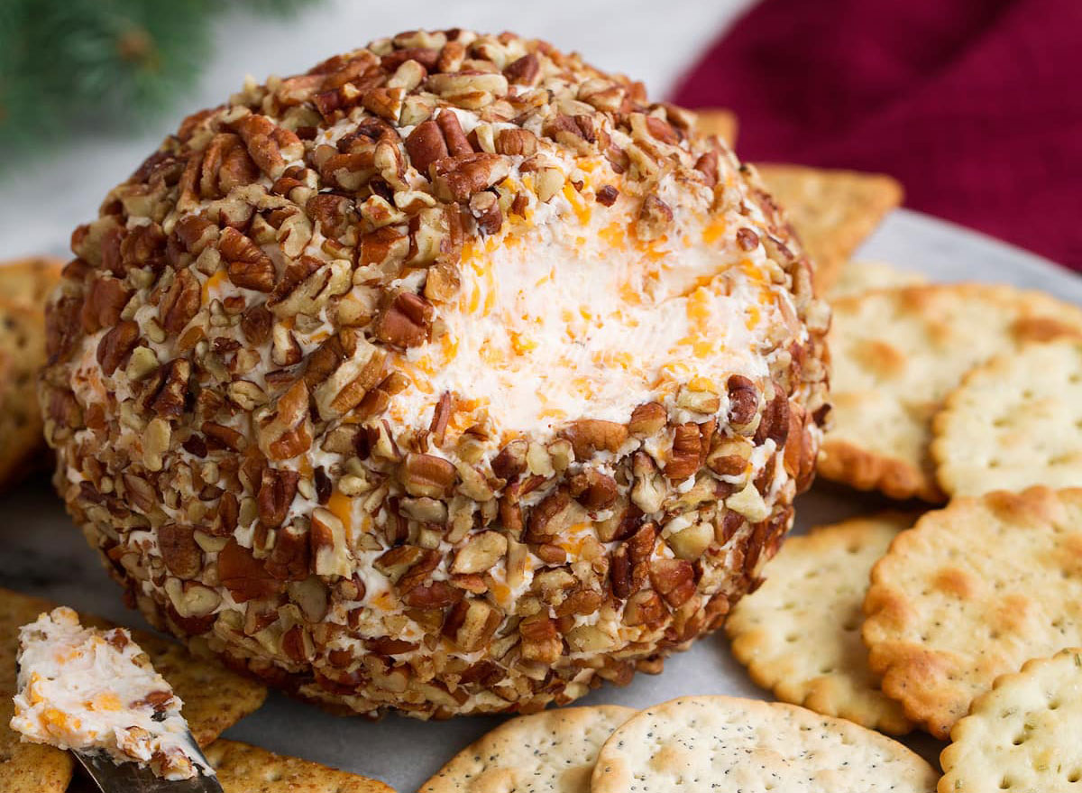 cheese ball appetizer covered in nuts with crackers