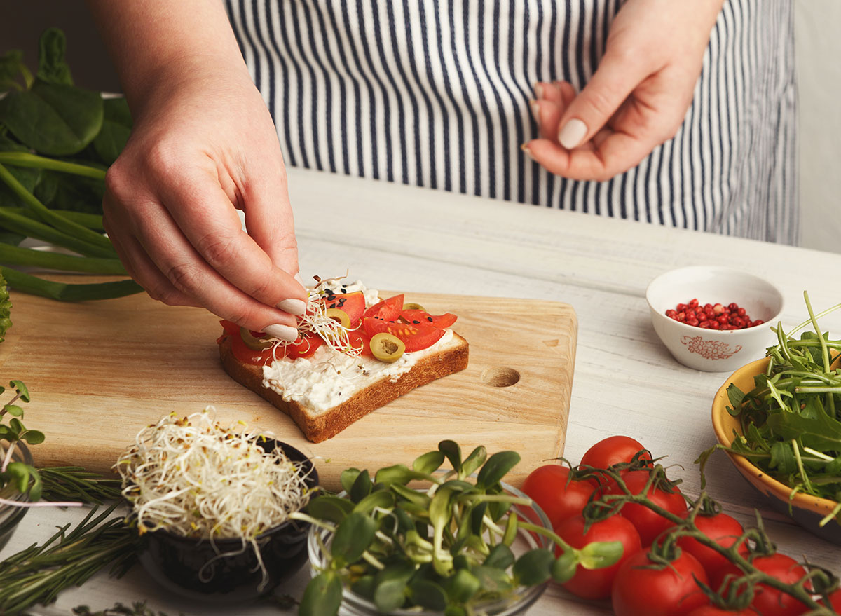 Chef adding toppings to toast for a high cholesterol diet plan